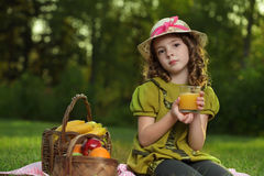 Girl with juice fruit Royalty Free Stock Photography