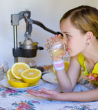 Girl and juicer Royalty Free Stock Images