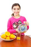 Girl and juicer Stock Photos