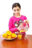 Girl and juicer Stock Images