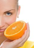 Girl with juicy orange Stock Images