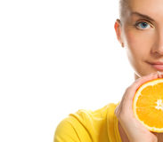Girl with juicy orange Royalty Free Stock Photos