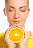 Girl with juicy orange. Beautiful girl with juicy orange Stock Photos