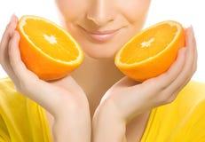 Girl with juicy orange Stock Photography