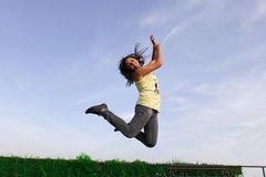 Girl juming. Happy girl jumping on meadow Stock Images