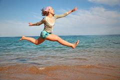 Girl in a jump Stock Images