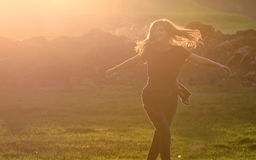 Girl jump against beautiful sunset in forest Stock Images