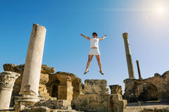 Girl in jump amid the ruins of Carthage in Tunisia Stock Images