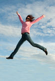 Girl in jump on background sky Royalty Free Stock Images