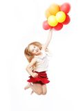 Girl jump with balloons Stock Images