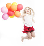 Girl jump with balloons Royalty Free Stock Image