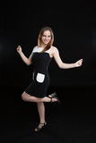 Girl jump in dress. Young girl in black and white dress jumping and smiling Stock Image