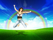Girl jump in a grass field with rainbow Stock Photo