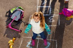 Girl jump on hopscotch Stock Photos
