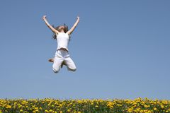 Girl in a jump, looking up Stock Photography