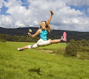 Girl jump on meadow Royalty Free Stock Image