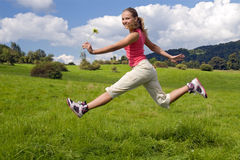 Girl jump on meadow Stock Image
