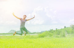Girl jump in the meadow with vintage filter Stock Photos