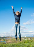 Girl in a jump over a cliff Royalty Free Stock Photography