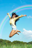 Girl jump in the park Stock Photography