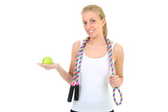 Girl with jump rope and apple Royalty Free Stock Images