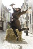 Girl jump on a street Stock Photos