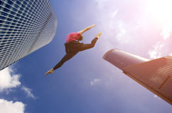 Girl jump between two skyscraper Royalty Free Stock Images