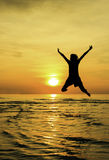 Girl jump welcome sunrise Stock Photography