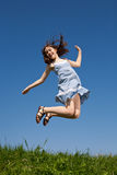 Girl jumping stock image