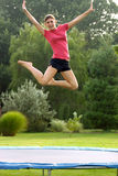Girl Jumping. Off of trampoline Royalty Free Stock Photography
