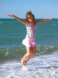 Girl jumping. Making look younger girl enjoys its rest on beach epidemic deathes Stock Images
