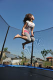 Girl jumping. On the trampoline Royalty Free Stock Photo
