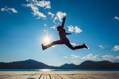 girl jumping Fotografering för Bildbyråer