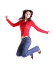 Girl jumping. A laughing girl jumping in front of a white background Royalty Free Stock Images