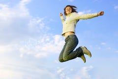 girl jumping Arkivfoton