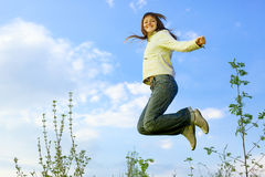 girl jumping Royaltyfria Bilder
