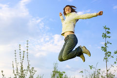 girl jumping Arkivfoto
