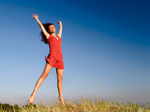 Girl jumping. On a dune Stock Images
