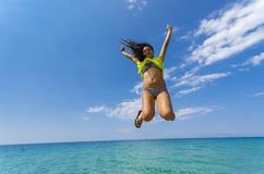 Girl jumping above water horizon Royalty Free Stock Photo