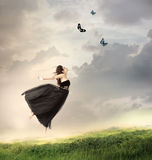Girl Jumping in the Air. Beautiful Girl Jumping in the Air on a Mountain Royalty Free Stock Images