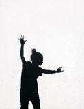Girl jumping  around on the white wall background Stock Images