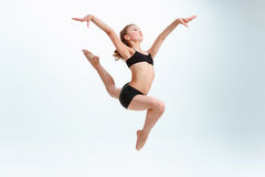The girl jumping as modern ballet dancer. At studio royalty free stock photos