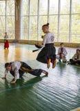 Girl jumping avoids hitting opponent Stock Photos