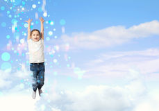 Girl jumping. On a background of blue sky Royalty Free Stock Photo