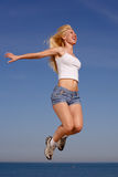 Girl jumping on background of sky Stock Image