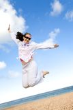 Girl jumping on the beach Royalty Free Stock Photography