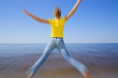 Girl jumping on the beach Royalty Free Stock Photos