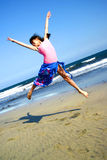 Girl jumping on beach Royalty Free Stock Photo