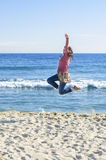 Girl Jumping on Beach Royalty Free Stock Photography
