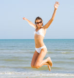 Girl jumping on a beach Royalty Free Stock Photography